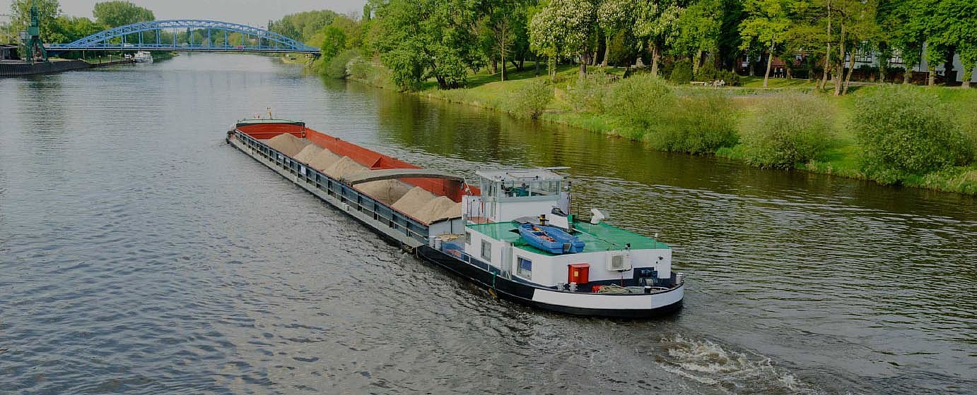 Bulk Inland Waterway vessel navigating on river/canal